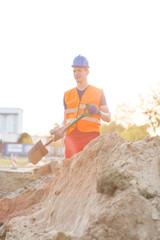 Street builder digging ground