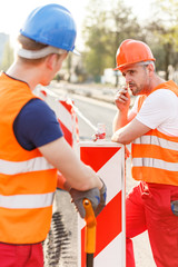 Construction workers in safety uniform