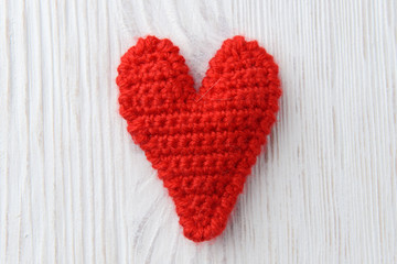 red heart on white wooden background