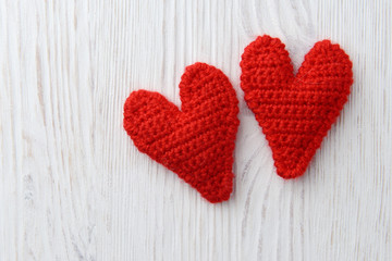 red hearts on white wooden background