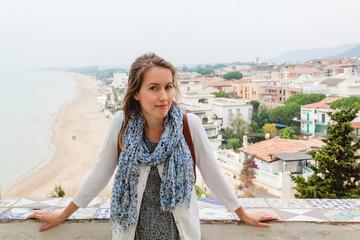 Girl standing in front of panoramic view in Sperlonga. Italy