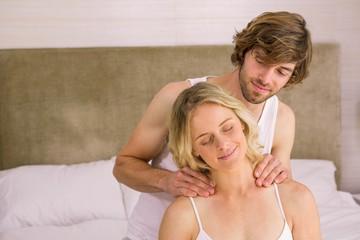 Boyfriend giving a massage to his girlfriend