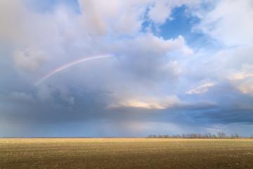rainbow on an abandoned field