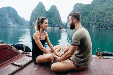 Couple travel on cruise ship, view on Ha long Bay