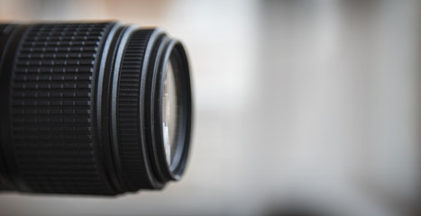 Close-up of a digital camera lens. Large copyspace.