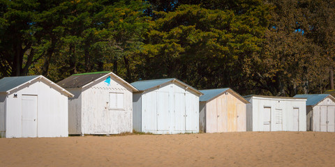 old white beach huts