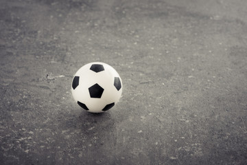 Miniature soccer ball toy still life. Concept of sport, leisure activity and football.