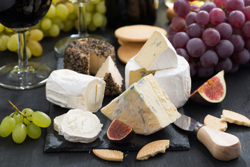 delicacy soft cheeses, fruit and crackers