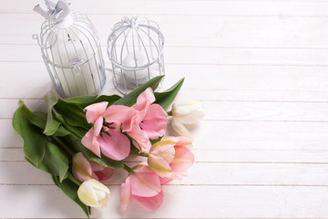 Fresh  spring white and pink  tulips and candles in decorative