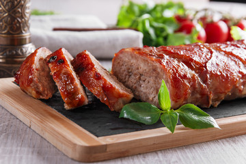 baked bacon wrapped  meatloaf with salad