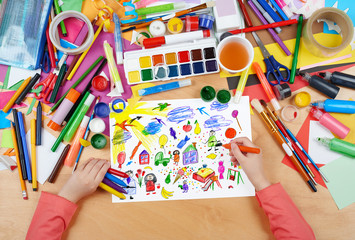 cartoon people and funny toy collection,  child drawing, top view hands with pencil painting picture on paper, artwork workplace