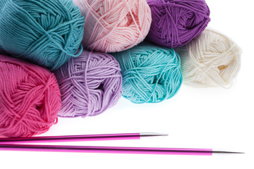 Colorful wool yarn hanks with knitting needles