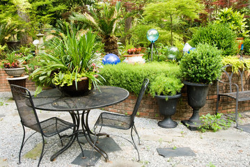 Outdoor Patio Furniture in a Landscaped Flower Garden