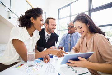 Businesspeople laughing in a meeting