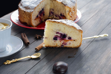 piece of cake with fruit and two cups of coffee