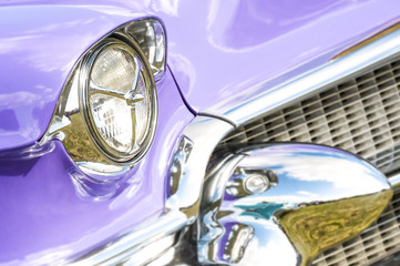 Wall Mural - 1950s classic vehicle with blurred chrome reflections