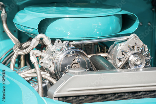 Wall mural chrome and turquoise blue vehicle engine bay