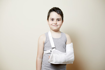 cute boy with broken arm