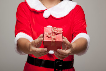 Asian Christmas girl with Santa Claus clothes and gift box