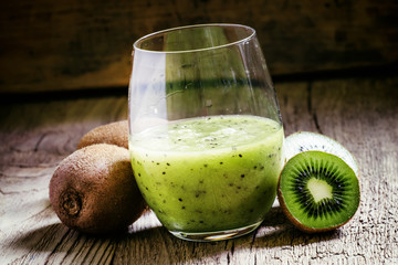 Freshly squeezed Smoothies kiwi fruit in a large glass, vintage