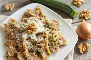 Wholegrain Pasta with topinambur cream, walnuts and zucchine