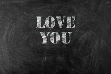 black chalk board with text love you
