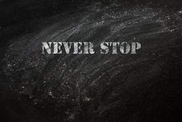 black chalk board with text never stop