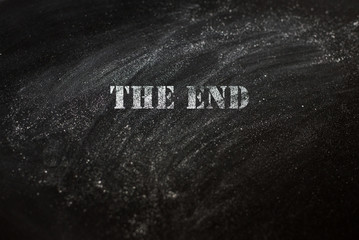 black chalk board with text the end