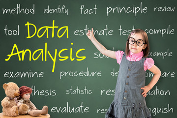 Cute little girl wearing business dress and showing data analysis concept on green chalk board.