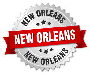 New Orleans  round silver badge with red ribbon