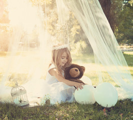 Beautiful Child Playing Outside Under White Canopy