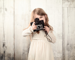 Creative Child Taking Photograph with Vintage Camera