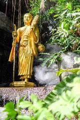 Golden statue of a buddhist monk