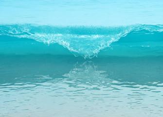 Powerful wave breaks along the shore Wall mural