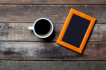 photo frame and cup of coffee