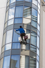 Window washer on the wall of a modern building