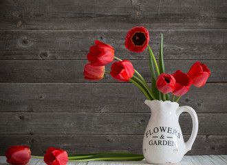 tulips bouquet on wooden background