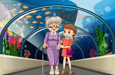 Grandmother and kid at aquarium