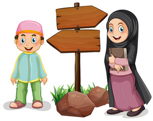 Two muslim kids and wooden signs