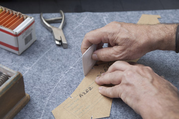 25 September 2012 at a tailor in Barcelona, Spain. Production process of suit tailoring. drawing the outline of parts of a tailored jacket