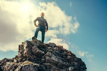 Man stay on the top of mountain