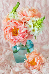 Floral composition with a pink peonies close-up.