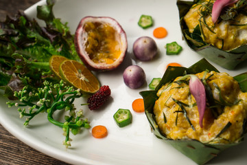 steam curry fish in banana leaf, authentic and decorative food