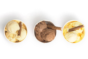 Three different sorts of homemade ice cream in paper cups