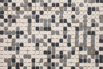 Abstract mosaic ceramic background of black, grey and white colors