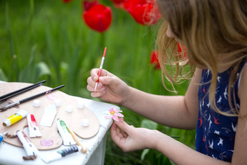 Young artist painting a landscape,  Painting Flowers