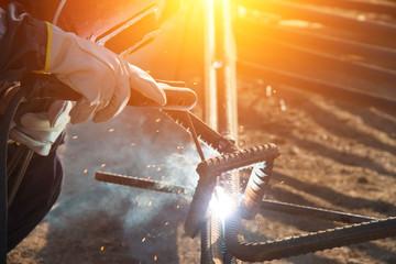 Welders welding