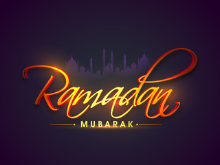 Glossy text with Mosque silhouette for Ramadan Mubarak.