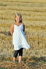 Beautiful girl enjoying the nature in the field