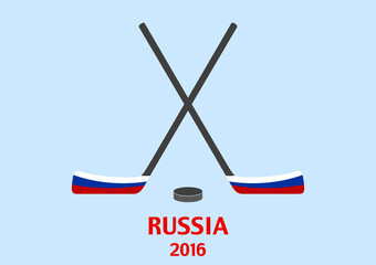 Hockey sticks and puck with the Russian flag